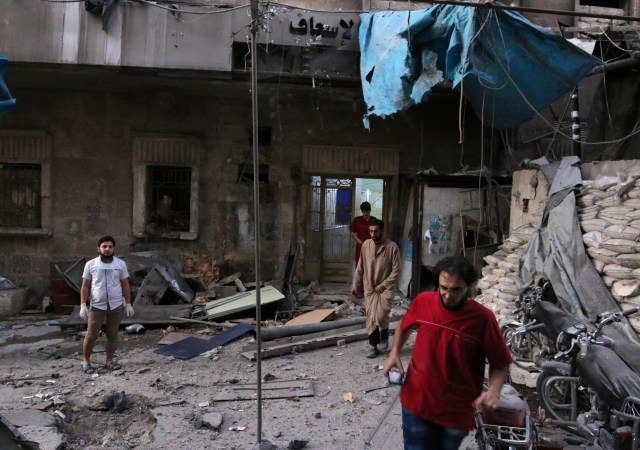 Medics inspect the damage outside a field hospital Sept. 27 after an airstrike in the rebel-held al-Shaar neighborhood of Aleppo, Syria. More than 200 airstrikes bombarded the city since Sept. 24, leaving more than100 civilians dead, with hundreds more injured, according to the head of the Syria Civil Defense group, a volunteer emergency medical service. (CNS photo/Abdalrhman Ismail, Reuters)