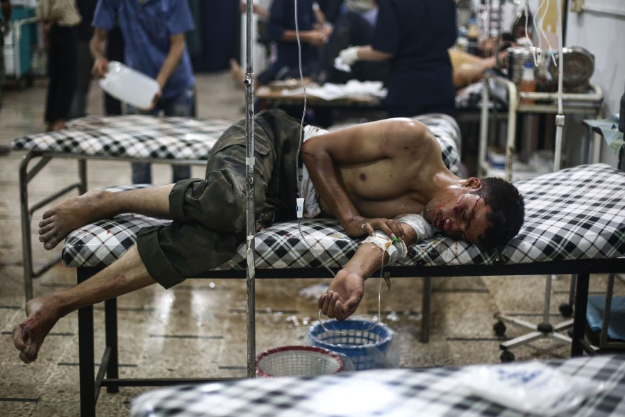 A young Syrian man receives medical treatment July 21 at a field hospital in the region of Douma in Damascus. (CNS/Reuters)