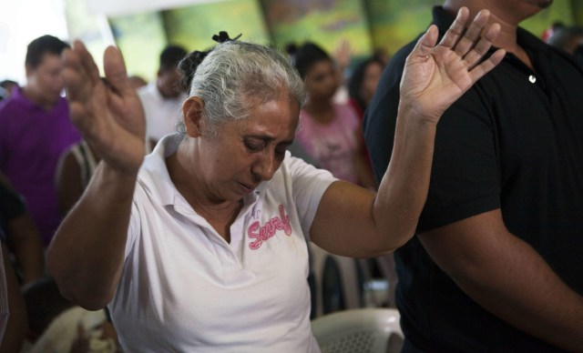 Lidia Tercero, whose son is on death row in Huntsville, Texas, prays during Mass in Managua, Nicaragua, in 2015 after her son, Bernardo, received a stay of execution. He was convicted of murdering a high school teacher while robbing a dry cleaning store in 1997. (CNS photo/Mario Lopez, EPA)