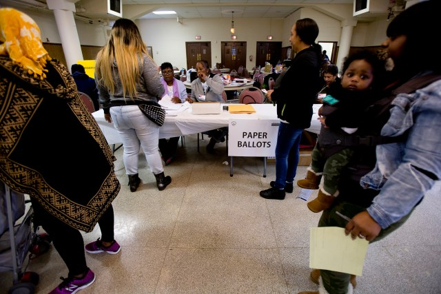 People wait to vote at St. Francis Xavier Church in Washington, Nov. 8. This edition of Viewpoints looks at the question: How do we move on after a contentious election? (CNS photo/Tyler Orsburn)