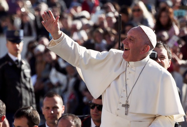 Pope Francis waves as he arrives to lead his Nov. 9 general audience in St. Peter's Square at the Vatican. (CNS/Reuters)