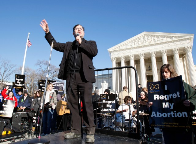 Father Frank Pavone, national director of Priests for Life, speaks in front of the U.S. Supreme Court at the 2009 March For Life in Washington. (CNS/Bob Roller)