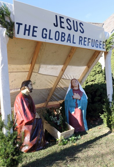 "A creche titled ""Jesus the Global Refugee"" is seen outside Our Lady of the Miraculous Medal Church in Wyandanch, N.Y., Nov. 27. The structure, designed as a refugee's lean-to, was created to call public attention to the biblical mandate to welcome immigrants and give shelter to refugees. (CNS/Gregory A. Shemitz)"