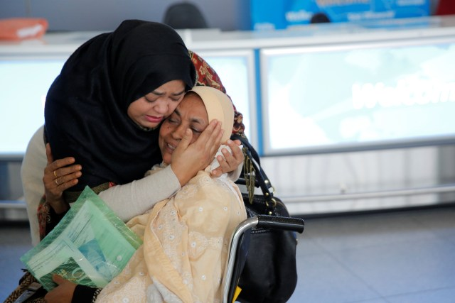 A woman greets her mother after she arrived from Dubai at John F. Kennedy International Airport in New York City Jan. 28. (CNS/Reuters)