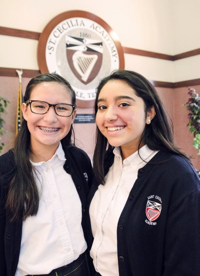 Valeria Santos and Grecia Andrade pose for a photo at St. Cecilia Academy in Nashville, Tenn. (CNS/Andy Telli, Tennessee Register)