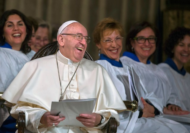 Pope Francis laughs during an evening prayer service at All Saints' Anglican Church in Rome Feb. 26. It was the first time a pope has visited an Anglican place of worship in Rome. (CNS/Maria Grazia Picciarella, pool)