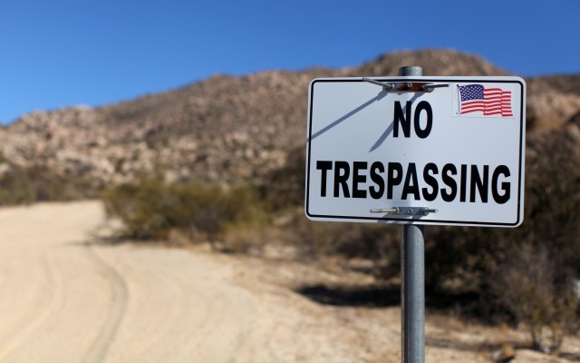 A sign stands on a private property near the U.S.-Mexico border fence in Jacumba, Calif. (CNS photo/Mike Blake, Reuters)