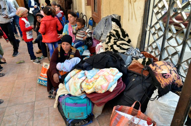 Displaced Egyptian Christian families, who used to live in the north of the Sinai Peninsula, sit near their belongings after arriving Feb. 24 at a church in Ismailia. Catholic churches in Ismailia, with help from Caritas, have helped Coptic Orthodox fleeing Islamic State attacks in North Sinai. (CNS/EPA)