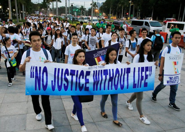 Participants carry a banner during a Feb. 18 protest against plans to reimpose the death penalty, promote contraceptives and intensify the drug war during Walk for Life in Manila. (CNS/Reuters)