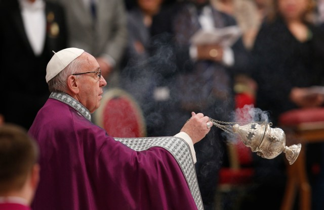 Pope Francis uses incense during a Lenten penance service in St. Peter's Basilica at the Vatican March 17. (CNS/Paul Haring)