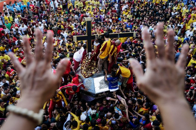 "Faithful in Manila, Philippines, celebrate the Black Nazarene Jan. 7. When Catholics are ""deaf to the word of God,"" their hearts are hardened, and ""they lose the meaning of faithfulness,"" Pope Francis said. (CNS/EPA)"