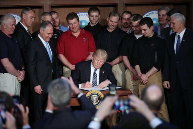 President Donald Trump signs an executive order titled
