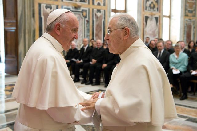 Pope Francis greets Norbertine Father Bernard Ardura, president of the Pontifical Committee for Historical Sciences, March 31 at the Vatican. The pope met with scholars taking part in a Vatican-sponsored congress on the Lutheran Reformation as part of the 500th anniversary commemorating the start of Luther's call for reform. (CNS/L'Osservatore Romano)