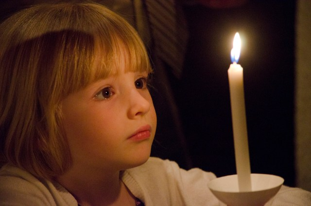 A girl is enamored of her Easter candle during the Easter Vigil April 15 in the Cathedral of the Immaculate Conception in Wichita, Kan. (CNS/Christopher Riggs, The Catholic Advance)