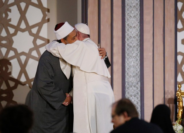 Pope Francis embraces Sheik Ahmad el-Tayeb, grand imam of al-Azhar University, at a conference on international peace in Cairo April 28. The pope was making a two-day visit to Egypt. (CNS/Paul Haring)