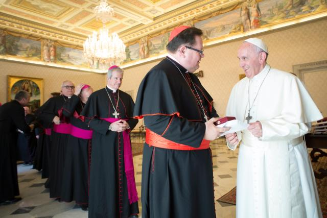 """Pope Francis greets Cardinal Gerald Lacroix of Quebec as he meets with Canadian bishops from Quebec during their """"ad limina"""" visits to the Vatican May 11. (CNS/L'Osservatore Romano)"""