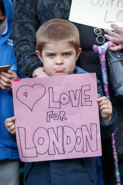 A boy holds a sign of condolence June 4 in Carlisle, England, for the victims of the London attacks a day earlier. (CNS/EPA)