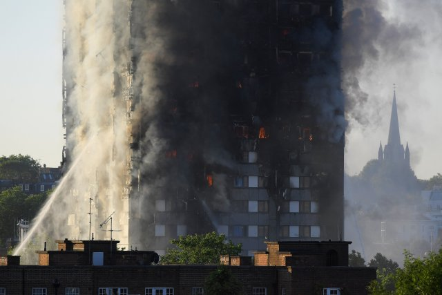 Flames and smoke billow from a London apartment building June 14.(CNS/Reuters)