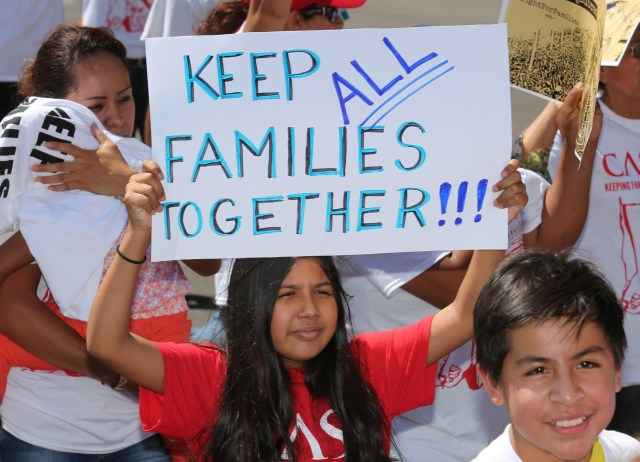 A girl displays a sign during an immigration march and rally in Washington in 2014. (CNS/Bob Roller)