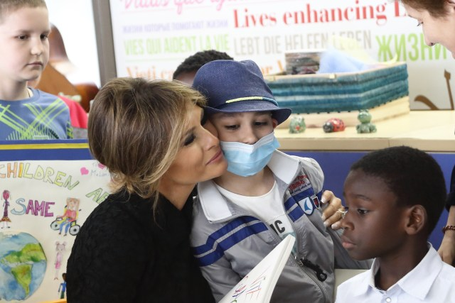 Melania Trump, wife of U.S. President Donald Trump, hugs a patient as she visits Bambino Gesu Hospital in Rome May 24. (CNS/Evandro Inetti, pool)