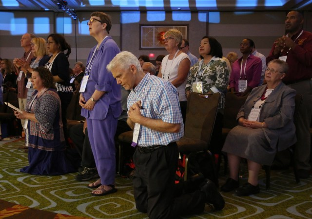 "Attendees pray during the opening Mass of the ""Convocation of Catholic Leaders: The Joy of the Gospel in America"" July 1 in Orlando, Fla. (CNS/Bob Roller)"