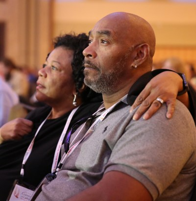 "Mary and Tyrone Lopez of the Archdiocese of Philadelphia listen to a speaker during the ""Convocation of Catholic Leaders: The Joy of the Gospel in America"" July 1-4 in Orlando, Fla. Leaders from dioceses and various Catholic organizations gathered for the event. (CNS photo/Bob Roller)"