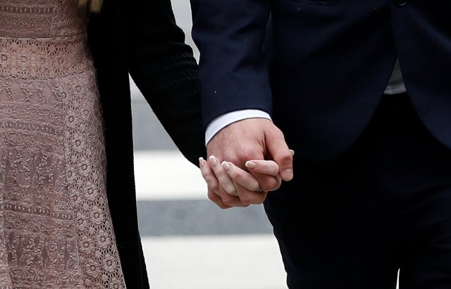 Connie Yates and Chris Gard hold hands as they arrive at the High Court in London July 24. Pope Francis is praying for the parents of Charlie Gard after a U.S. doctor told them nothing could be done to help their son, who suffers from encephalomyopathic mitochondrial DNA depletion syndrome. (CNS/Reuters)
