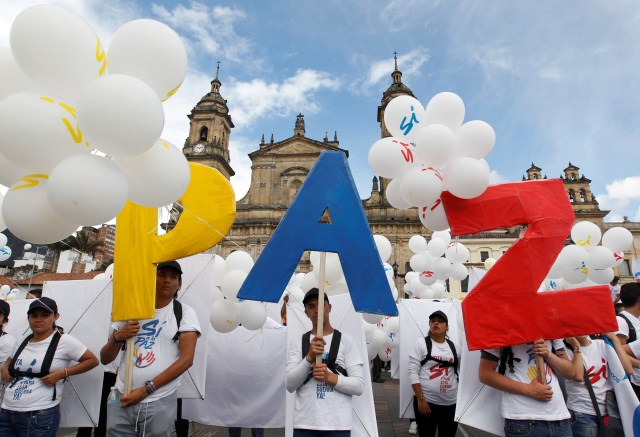 People form the word peace outside the cathedral in Bogota, Colombia, last September. (CNS/Reuters)