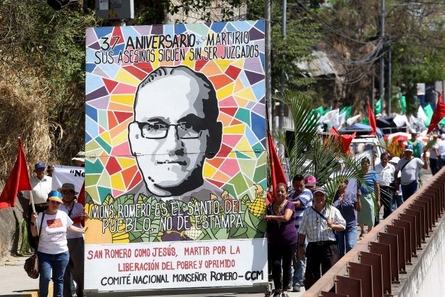 People participate in a late-March procession to commemorate the 37th anniversary of the killing of Blessed Oscar Romero in San Salvador, El Salvador. A pilgrimage to celebrate the slain archbishop's 100th birthday will be held Aug. 11-13. (CNS/EPA)