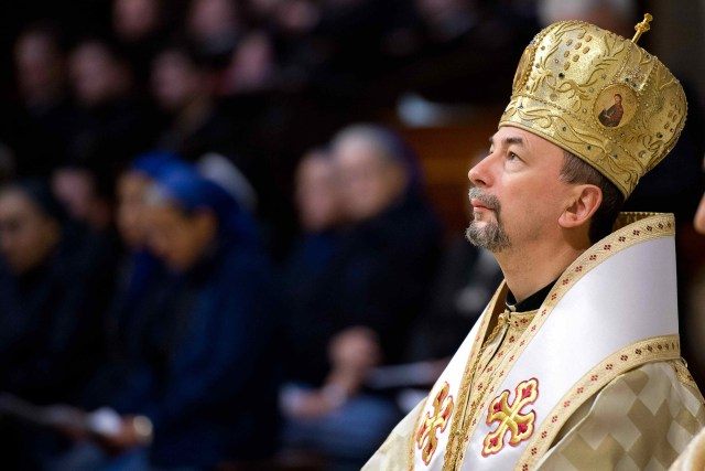Slovak Archbishop Cyril Vasil, secretary of the Congregation for Eastern Churches, prays at the Mass opening a plenary meeting of the congregation in this 2013 file photo. The congregation is celebrating the 100th anniversary of its establishment as a Vatican office dedicated to supporting the Eastern Catholic churches and ensuring their liturgies, spirituality and traditions continue to be part of the universal Catholic Church. (CNS/L'Osservatore)