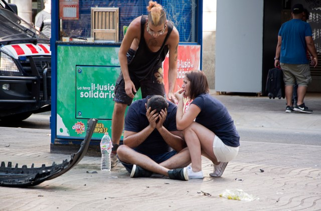 Injured people react after a van crashed into pedestrians in the Las Ramblas district of Barcelona, Spain, Aug. 17. (CNS/EPA)