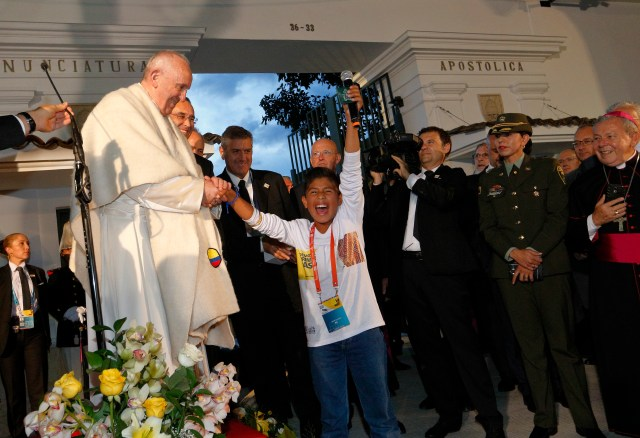 A boy cheers as he greets Pope Francis outside the Apostolic Nunciature in Bogota, Colombia, Sept. 6. The pope plans to visit four Colombian cities during his six-day trip. (CNS/Paul Haring)