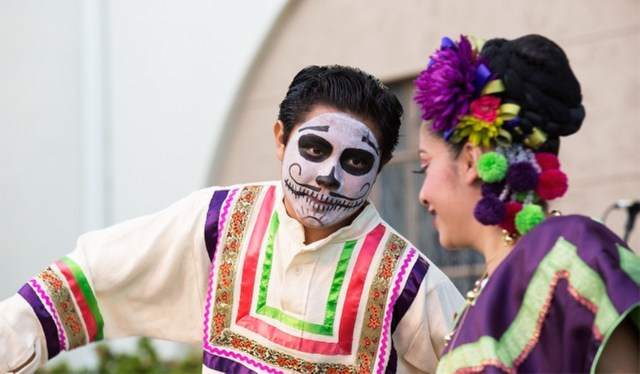 Children in costumes perform during a traditional Dia de los Muertos (Day of the Dead) vigil in 2014 at Calvary Cemetery in East Los Angeles. (CNS file/Victor Aleman, Vida-Nueva.com)