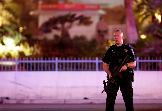 A police officer stands in front of the Tropicana hotel-casino in Las Vegas Oct. 2 after a mass shooting at a music festival. (CNS/Steve Marcus, Las Vegas Sun)