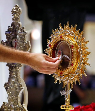 A worshipper venerates the relics of St. Padre Pio at St. Francis Borgia Church in Chicago Sept. 25. His relics were on a nationwide tour Sept. 16-Oct. 8 marking the 130th anniversary of his birth and the 15th anniversary of his canonization. (CNS photo/Karen Callaway, Chicago Catholic)
