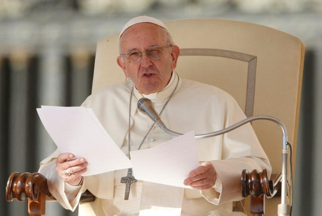 Pope Francis speaks during his general audience in St. Peter's Square at the Vatican Oct. 11. (CNS/Paul Haring)