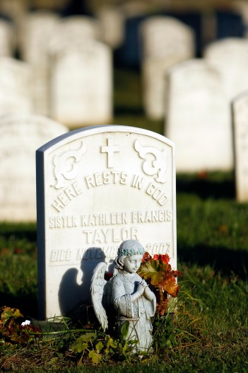 An angel figurine is seen near a headstone in 2016 at the cemetery at the motherhouse of the Sisters of St. Dominic of Amityville, N.Y. (CNS/Gregory A. Shemitz)