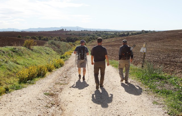 Father Vincent Gilmore, tour leader Bret Thoman and Deacon Terrance Marcell walk the historic pilgrimage route of St. Francis from Assisi to Rome Oct. 23. (CNS/Robert Duncan)