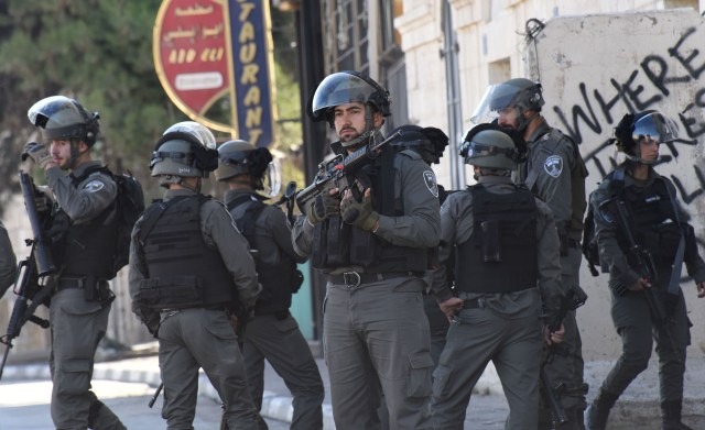 Israeli security forces get orders in Bethlehem, West Bank, as Palestinians protest U.S. President Donald Trump's recognition of Jerusalem as Israel's capital. (CNS/Debbie Hill)
