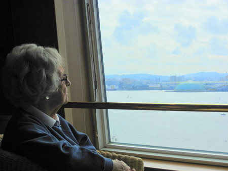 Elderly woman looking from a window