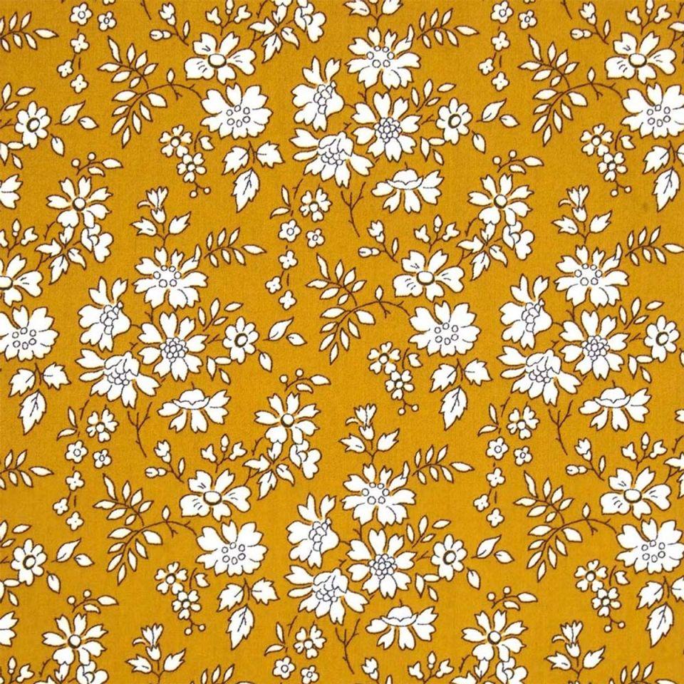 Tissu liberty fond jaune moutarde à motifs fleurs blanches