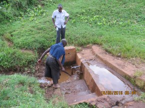 A protected open well supplying water to resservoir tanks