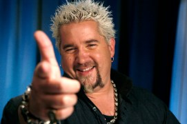 """FILE - In this May 4, 2011 file photo, TV personality Guy Fieri poses for a portrait Wednesday, May 4, 2011 in New York. Fieri, who hosts the NBC game show """"Minute To Win It,"""" talks about how he transformed the fixer upper into a sprawling ranch-style home with a 900-square-foot kitchen. (AP Photo/Jeff Christensen, file)"""