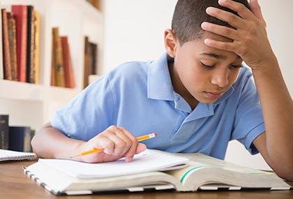 Boy doing homework ADHD
