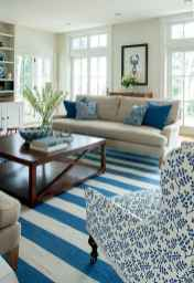 70 Cool and Clean Coastal Living Room Decorating Ideas (25)