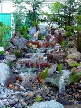 25 Stunning Backyard Ponds Ideas With Waterfalls (24)