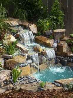 25 Stunning Backyard Ponds Ideas With Waterfalls (8)