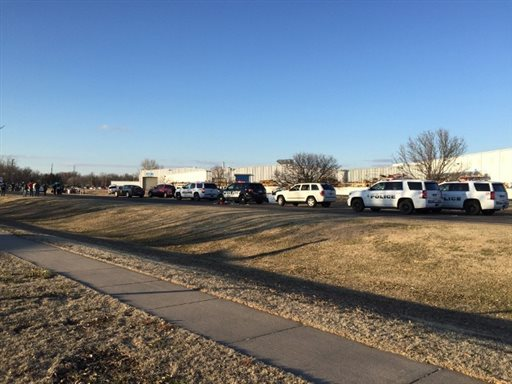 In this photo provided by KWCH-TV, police vehicles line the road after reports of a shooting in Hesston, Kan., Thursday, Feb. 25, 2016. A Harvey County sheriff's dispatcher said the shooting occurred Thursday afternoon at Excel Industries. (KWCH-TV via AP) MANDATORY CREDIT