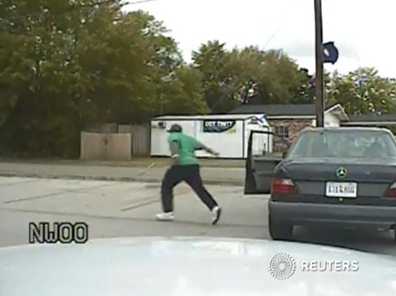 A still image taken from police dash cam video allegedly shows Walter Scott running from his vehicle during a traffic stop before he was shot and killed by white police officer Michael Slager in North Charleston, South Carolina, in this file photo received April 7, 2015. REUTERS/South Carolina Law Enforcement Division/Handout via Reuters/Files