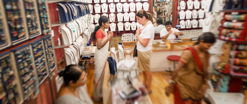 Ellie bargain hunting in a Jewish Quarter shop